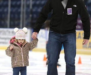 Dustin Rivera of Girard helps his daughter, Camille(3) skate during First Night Youngstown, Sunday, Dec. 31, 2017, at the Covelli Centre in Youngstown. ..(Nikos Frazier | The Vindicator)