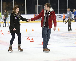 Tyler Hostefler and Megan Schneider hold hands as they ice skate during First Night Youngstown, Sunday, Dec. 31, 2017, at LOCATION in Youngstown. ..(Nikos Frazier | The Vindicator)