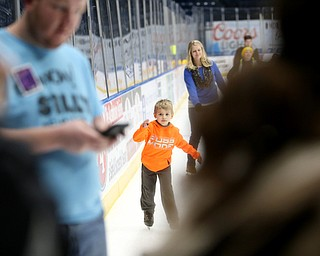 Geffery Lafleme(6) of Salem ice skates in front of his sister, Jessica Valsi(blue) during First Night Youngstown, Sunday, Dec. 31, 2017, at LOCATION in Youngstown. ..(Nikos Frazier | The Vindicator)