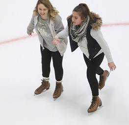 Mia Moran(17) and Marina Sepulveda(13) hold hands as they ice skate during First Night Youngstown, Sunday, Dec. 31, 2017, at LOCATION in Youngstown. ..(Nikos Frazier | The Vindicator)