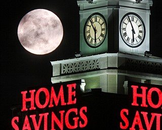 William D. Lewis the Vindicator A super moon rises over the Home Savings clock tower in downtown in Youngsotwn Monday Jan 1 2018. This super moon is known as the Wolf moon.