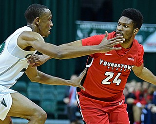 YOUNGSTOWN, OHIO - JANUARY 1, 2018: Youngstown State's Cameron Morse looks to pass while being guarded by Cleveland State's Bobby Word during the first half of their game on Saturday afternoon at the Wolstein Center. Youngstown State won 80-77. DAVID DERMER | THE VINDICATOR