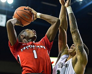 YOUNGSTOWN, OHIO - JANUARY 1, 2018: Youngstown State's Braun Hartfield puts up a shot over Cleveland State's Anthony Wright during the second half of their game on Saturday afternoon at the Wolstein Center. Youngstown State won 80-77. DAVID DERMER | THE VINDICATOR