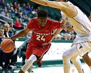 YOUNGSTOWN, OHIO - JANUARY 1, 2018: Youngstown State's Cameron Morse drives on Cleveland State's Stefan Kenic during the second half of their game on Saturday afternoon at the Wolstein Center. Youngstown State won 80-77. DAVID DERMER | THE VINDICATOR