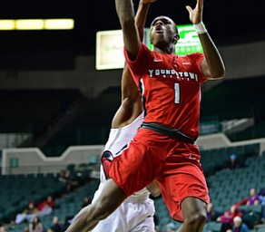 YOUNGSTOWN, OHIO - JANUARY 1, 2018: Youngstown State's Braun Hartfield goes to the basket against Cleveland State's Kenny Carpenter during the second half of their game on Saturday afternoon at the Wolstein Center. Youngstown State won 80-77. DAVID DERMER | THE VINDICATOR