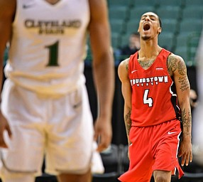 YOUNGSTOWN, OHIO - JANUARY 1, 2018: Youngstown State's Jaylen Benton celebrates after hitting a three point shot during the second half of their game on Saturday afternoon at the Wolstein Center. Youngstown State won 80-77. DAVID DERMER | THE VINDICATOR..Cleveland State's Kasheem Thomas pictured.