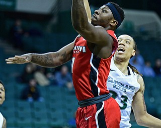 YOUNGSTOWN, OHIO - JANUARY 1, 2018: Youngstown State's Tyree Robinson goes to the basket against Cleveland State's Jamarcus Hairston during the first half of their game on Saturday afternoon at the Wolstein Center. Youngstown State won 80-77. DAVID DERMER | THE VINDICATOR
