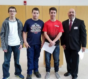 Austintown Fitch students recently attended Youngstown State University's National Manufacturing Day and were awarded new equipment. Makaila Yuschak, 10th grade; and Jazalynn Lopez, 11th grade, took first-place honors and were awarded a desktop personal-use 3D printer and a 3D print of a coin bank. Above, from left, are Colin Smith, Robert Hoffman and Larry Iagullli, ninth-grade students who won second place and received a 3D printer pen for their design and 3D print of an iPhone cord organizer, and Dr. Darrell Wallace, associate professor of mechanical and industrial engineering at YSU. Below are Yuschak and Wallace.