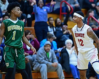 WARREN, OHIO - JANUARY 2, 2017: JFK's Byron James stares down Ursuline's Deshaun Harris after he hit a three point basket during the first half of their game on Tuesday night at Warren JFK High School. DAVID DERMER | THE VINDICATOR