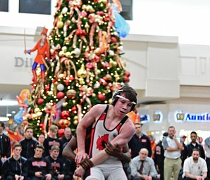 NILES, OHIO - JANUARY 3, 2018: Canfield's Nick Barber attempts to break free from the grasp of Howland's Dylan Shields during their 106lb bout, Wednesday nigh at the Eastwood Mall. DAVID DERMER | THE VINDICATOR