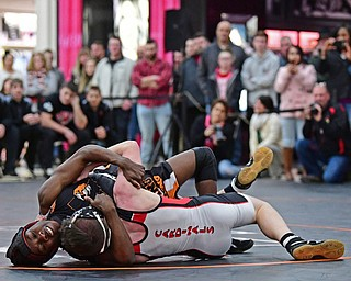 NILES, OHIO - JANUARY 3, 2018: Howland's Isaiah Lyles attempts to work Canfield's Chris Mauch onto his back during their 120lb bout, Wednesday nigh at the Eastwood Mall. DAVID DERMER | THE VINDICATOR