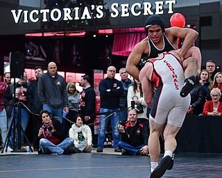 NILES, OHIO - JANUARY 3, 2018: Howland's Brandon Matlock fights to avoid being taken down by Canfield's Tyler Stein during their 220lb bout, Wednesday nigh at the Eastwood Mall. DAVID DERMER | THE VINDICATOR
