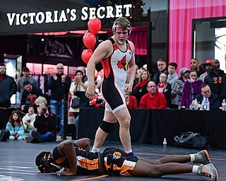 NILES, OHIO - JANUARY 3, 2018: Canfield's Dan Kapalko stares down Howland's Chris Julian after pinning him to end their 285lb bout, Wednesday nigh at the Eastwood Mall. DAVID DERMER | THE VINDICATOR