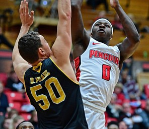 YOUNGSTOWN, OHIO - JANUARY 4, 2017: Youngstown State's Tyree Robinson shoots over Milwaukee's Brett Brahl during the first half of their game, Thursday night at Beeghly Center. DAVID DERMER | THE VINDICATOR