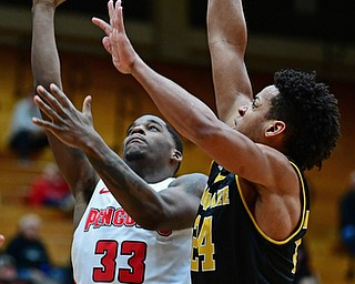 YOUNGSTOWN, OHIO - JANUARY 4, 2017: Youngstown State's Naz Bohannon goes to the basket against Milwaukee's Bryce Nze during the first half of their game, Thursday night at Beeghly Center. DAVID DERMER | THE VINDICATOR