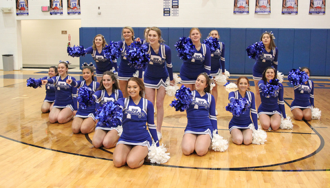 The Poland Bulldog cheerleaders perform a cheer before the start of Thursday nights matchup against Struthers at Poland    Dustin Livesay  |  The Vindicator  1/4/18  Poland.