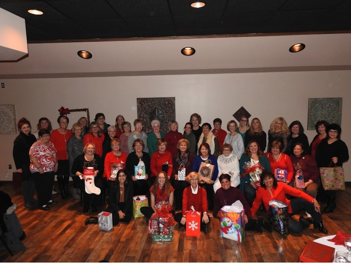 "The GFWC Ohio Austintown Junior Women's League recently hosted its annual Christmas dinner at Tavola's in Austintown. Members enjoyed a buffet and made plans for a fundraiser, ""A Taste of Austintown,"" that will take place March 1. A collection was taken to purchase gift cards for several needy families in the Austintown area. For information about AJWL visit www.austintownjuniorwomensleague.org. Seated on the floor, from left, are Brittany Bueno, Jessica Munger, Kathy Mock, Janet Polish and Ruty Rodriguez-Patterson. Seated are Colleen Miller, Janie Surman, Marcia Denamen, Marie Dockry, Paulette Dockry, Sue Hovanec, Shirley Schmidt, April McGahagan, Eileen Frost and Karma Minkewicz. Standing are Judy Rodkey, Jennifer Bodnar, Tiffany Shaffer, Genevieve Bodnar, Nancy Jones, Eileen Lozier, Chrissy Bloom, Dawn Blinsky, Sandy Gaskill, Evie Moore, Janice Simmerman, Donna Wear, Linda Jones, MaryAnn Herschel, Shari Beelen, Joann Sulenski, Maribeth McGlynn, Lynn Larson, Lauren Wolfgang, Stephanie Oyster, Cynthia Ciriaco, Peggy Bennett, Mary Kay Erickson and Ellen Kosa."