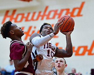 HOWLAND, OHIO - JANUARY 5, 2018: Howland's Samari Dean goes to the basket against Boardman's Derrick Anderson during the first half of their game, Friday night at Howland HigH School. DAVID DERMER | THE VINDICATOR
