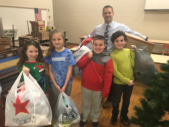 Third- and fourth-grade students at Dobbins Elementary School started collecting winter items at the beginning of December for the giving tree. Six bags, five boxes and 21 coats were collected for donation to Mahoning County Children Services. The community service project has been a tradition at the school for over a decade and was a mission of former principal, Mrs. Borovitcky, who set things in motion. Above, from left, are Kennedy Henderson, fourth grade; Margaux Malloy, fourth grade; Parker Ogden, third grade; Vincent Raspanti, third grade; and Mike Daley, principal.