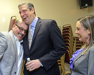 William D. Lewis the Vindicator  Al Adi, left, shares a moment with US rep Tim Ryan as Ryan's wife Andrea looks on during  victory party at tArab American Community Center in Liberty for Adi who won a stay of deportation.