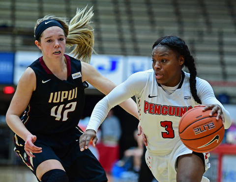 YOUNGSTOWN, OHIO - JANUARY 6, 2017: oungstown State's Indiya Benjamin drives on IUPUI's Sydney Hall during the second half of their game, Saturday afternoon at Beeghly Center. IUPUI won 65-43. DAVID DERMER | THE VINDICATOR