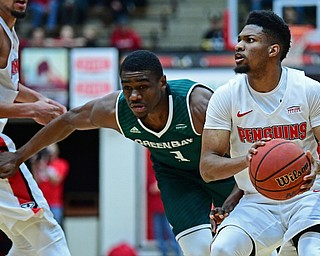 YOUNGSTOWN, OHIO - JANUARY 6, 2017: Youngstown State's Cameron Morse looks to the basket after avoiding Green Bay's Khalil Small during the first half of their game, Saturday night at Beeghly Center. DAVID DERMER | THE VINDICATOR