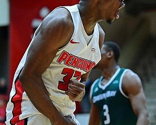YOUNGSTOWN, OHIO - JANUARY 6, 2017: Youngstown State's Garrett Covington celebrates after Green Bay knocked the ball out of bounds giving possession to YSU late in the second half of their game, Saturday night at Beeghly Center. DAVID DERMER | THE VINDICATOR