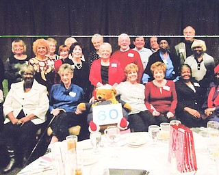 East High School classmates gathered for their 60th class reunion in December at Johnny's Restaurant in Boardman. In front, from left, are Jeanne Cernock Mahon, Cleo Mosley, Bertha Bandi Hill, East High Golden Bear, Carmel Canacci Baughman, Roseann Gaudio Ferraro, Catherine Perkins Coleman and Jewell Boswell Hudson. In row two are Carol Thomas Crann, Patricia Petretic Hannis, Marian Cacivilano Jordan, Marlene Desiato DePietro, Larry Fauver, Ann Jackson and Lorraine Curry Thomas. In back are Dorothy Rogers Shaw, Sandra DelPlato Shellito, Judy Adams Kosek, Marie Rago Karas, Geraldine Guerrieri Kurian, Joseph Haas, Sam Fisher, Lewis Galante and Robert Demechko. Al Zarbaugh also attended the event.