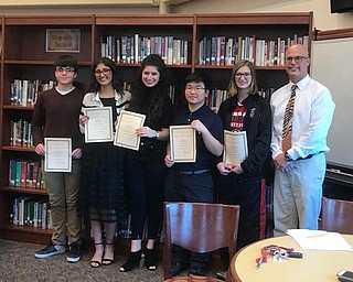 Girard City School board recently honored 20 students as outstanding leaders for the 2017 Twenty Under 20 program, which is co-sponsored by Kent State Trumbull, The Tribune Chronicle and Akron Childrens Hospital Mahoning Valley. The program recognizes high achieving students for their leadership skills through volunteerism, extracurricular activities and academics. Sarah Ryser, a senior, received a $500 grant to a charity of her choice in recognition of community service. Students from the following schools also were honored: Harding, Hubbard, Chalker, Niles, JFK, Lakeview and Lordstown. Above, from left, are Anthony Costarella, Ryser, Francesca Byrne, Richard Park, Megan Fiedler and William Ryser, principal.