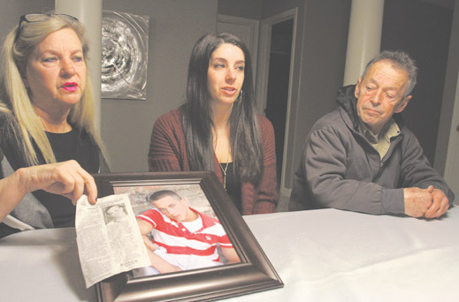 After Johnson died of an overdose at 27, his mother, Cheryl Puskas, left; sister, Courtney (Puskas) Worley; and father, Gus Johnson III, spoke out about Jordan's struggle with addiction. His mother is holding his portrait and his obituary, in which she shared the story of his struggle in the hope it will help other families.