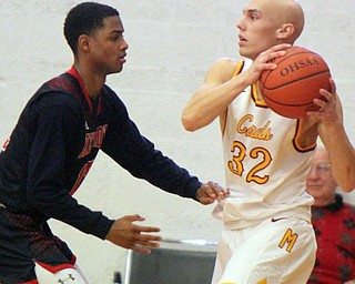 William D. Lewis The Vindicator Mooney's Jonnie Mikos(32) keeps the ball from JFK's  Byron Taylor(12)