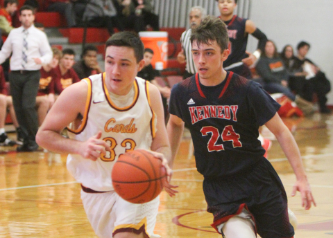 William D. Lewis The Vindicator JFK's Kasin Platt(24) and  Mooney'sJohnny Murphy(33)