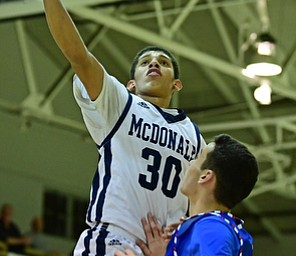McDONALD, OHIO - JANUARY 9, 2018: McDonald's Braedon Poole goes to the basket against Western Reserve's Dom Velasquez during the second half of their game, Tuesday night at McDonald High School. DAVID DERMER | THE VINDICATOR