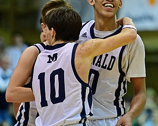 McDONALD, OHIO - JANUARY 9, 2018: McDonald's Braedon Poole is congratulated by Rico Rodriguez and Josh Celli after scoring his 1000th career point during the second half of their game, Tuesday night at McDonald High School. DAVID DERMER | THE VINDICATOR
