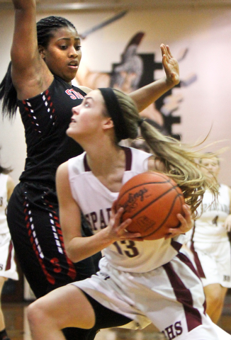 William D. Lewis  The Vindicator  Boardman's Cate Green(13) drives to the hoop past Struthers'Kahylah Brown(1) during 1-10-18 action at Boardman