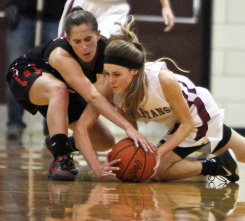 William D. Lewis  The Vindicator  Struthers Michelle Buser(22), left, and Boardman's during 1-10-18 action at Boardman's Cate Green(13) go for a loose ball.