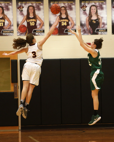 Ursuline's Lindsay Bell (35) goes up for three as South Range's Izzy Lamparty (3) attempts to block her shot in the first half of an OSHAA girls high school basketball game, Thursday, Jan. 11, 2018, in Canfield. South Range won 54-49...(Nikos Frazier | The Vindicator)