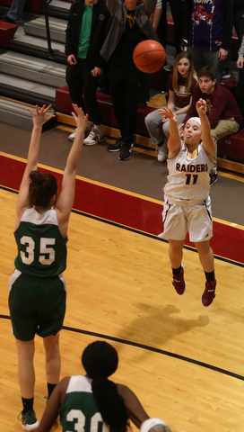 South Range's Bri Modic (11) goes up for three as Ursuline's Lindsay Bell (35) attempts to block her shot in the second half of an OSHAA girls high school basketball game, Thursday, Jan. 11, 2018, in Canfield. South Range won 54-49...(Nikos Frazier | The Vindicator)