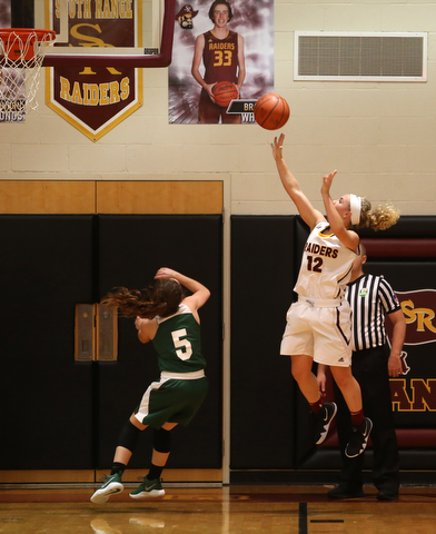 South Range's Bree Kohler (12) goes up for two over Ursuline's Cara McNally (5) in the second half of an OSHAA girls high school basketball game, Thursday, Jan. 11, 2018, in Canfield. South Range won 54-49...(Nikos Frazier | The Vindicator)