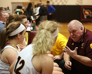 South Range head coach Tony Matisi talks his players during a timeout in the second half of an OSHAA girls high school basketball game, Thursday, Jan. 11, 2018, in Canfield. South Range won 54-49...(Nikos Frazier | The Vindicator)