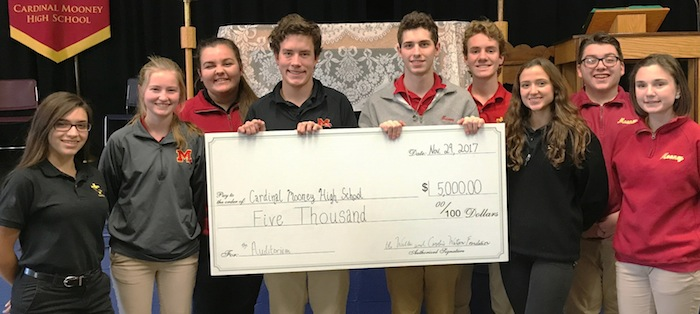 Cardinal Mooney High School received a $5,000 grant from the Walter and Caroline Watson Foundation through the PNC Charitable Trust for upgrades to its auditorium. The funding will assist in upgrading technology, electrical infrastructure, aesthetic renovations and physical enhancements to the space in an effort to keep up with the expansion of the school's theater department, speech and debate team and technology in classroom programming. To pledge individual or group donations for the upgrades, visit www.cardinalmooney.com/support. Above, from left, are Alexandria Patrone, Maureen Baker, Olivia Carfolo, Clark Hergenrother, Brady Bizon, Matthew Rossi, Adriana Vennetti, Joseph Neider and Kathleyna Wilkins.