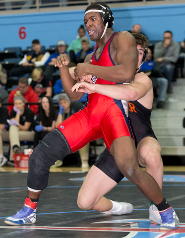 ALLIANCE, OHIO - JANUARY 10, 2018: TOP GUN WRESTLING- Austintown's Breylon Douglas (red) is in the grasp of Hoover'sBen Smith (black) in the championship 195 lbs match at Alliance High School.  MICHAEL G TAYLOR | THE VINDICATOR