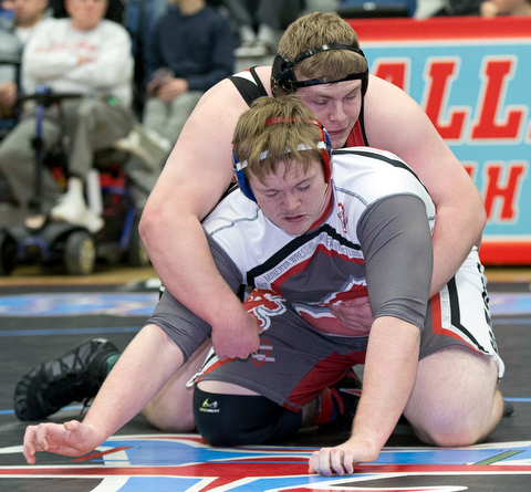 ALLIANCE, OHIO - JANUARY 10, 2018: TOP GUN WRESTLING- Girard'sJack Delgarbino (red) is control against Minerva's Travis Kuttler (gray) in the championship 285 lbs match at Alliance High School.  MICHAEL G TAYLOR | THE VINDICATOR