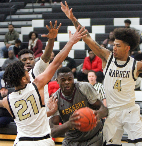 William D. Lewis The Vindicator Kennedy's Oscar Tshiebwe(50)  is hemmed in by Harding'sTyre Marlowe(21) Terrion Jackson(1) and Chris Hughes(4) during 1-17-18 action at Harding