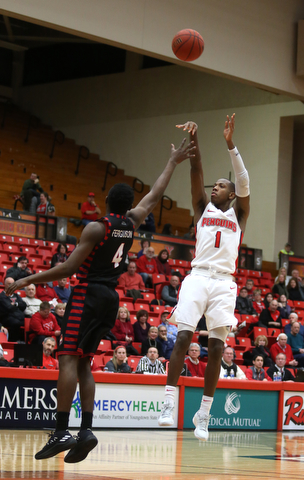 Youngstown State guard Braun Hartfield (1) goes up for three as UIC guard Tarkus Ferguson (4) attempts to block his shot in the first half of a NCAA college basketball game, Thursday, Jan. 18, 2018, in Youngstown. UIC won 92-78...(Nikos Frazier | The Vindicator)