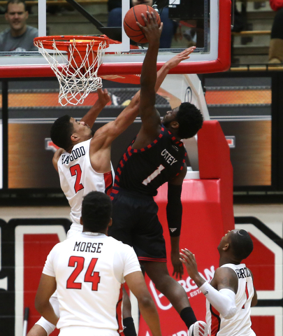 UIC guard Marcus Ottey (1) goes up for a layup as Youngstown State forward Devin Haygood (2) attempts to block his shot in the first half of a NCAA college basketball game, Thursday, Jan. 18, 2018, in Youngstown. UIC won 92-78...(Nikos Frazier | The Vindicator)