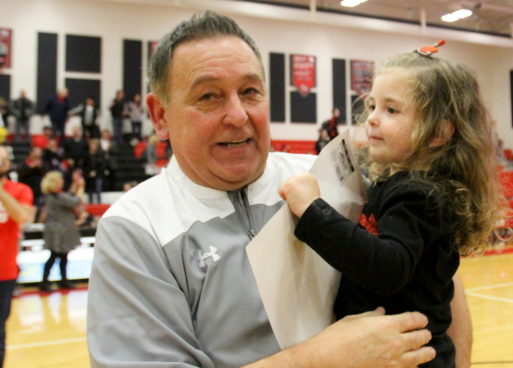William D. Lewis The Vindicator Girard girls coach Andy Saxon celbrates his 400th career win against Lakeside 1-22-18  at Girard while carrying hsi daughter Brinley, 4, after the game..