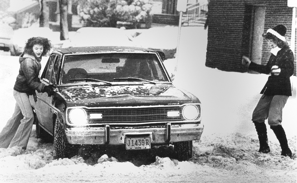 1978 Blizzard  Extricating their car from a snow drift at Lakeside and Mahoning Ave in Youngstown are YSU students Linda Joseph, Sheri Jakubek and Tyna Chance.