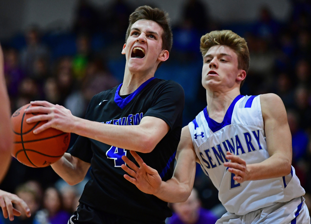 POLAND, OHIO - JANUARY 26, 2018: Lakeview's TJ Lynch, left, drives on Poland's Mike Diaz during the second half of their game on Friday night at Poland High School. DAVID DERMER | THE VINDICATOR