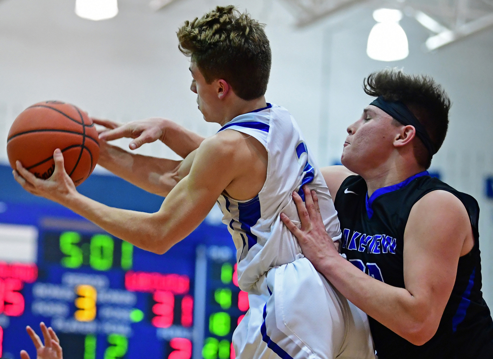 POLAND, OHIO - JANUARY 26, 2018: Poland's Mike Diaz grabs a rebound away from Lakeview's Drew Munno during the second half of their game on Friday night at Poland High School. DAVID DERMER | THE VINDICATOR